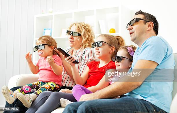 Family Watching TV With 3D Glasses.