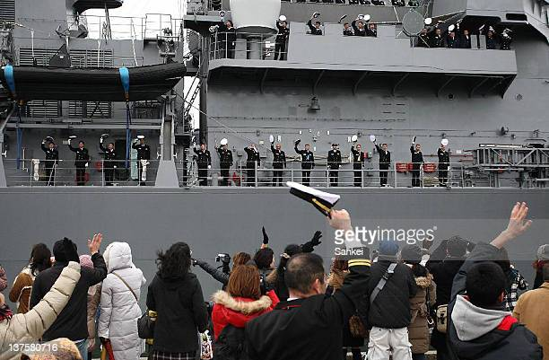 Family wave to the members of SelfDefense Force during the seeoff ceremony of SelfDefense Force to Aden Gulf at Japan Maritime SelfDefense Force...