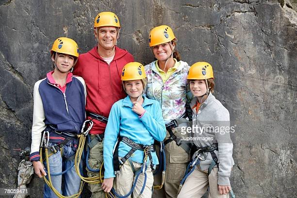 Family wearing rock climbing gear