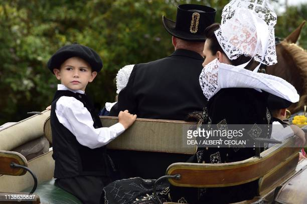 Family wearing traditional costumes Festival of Blue Nets Concarneau Brittany France