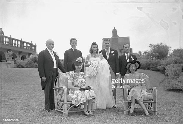 Family wedding portrait of Henry Ford II and new wife former Anne McDonnell includes James F and Anna McDonnell the bride's parents Fulton J Sheen...