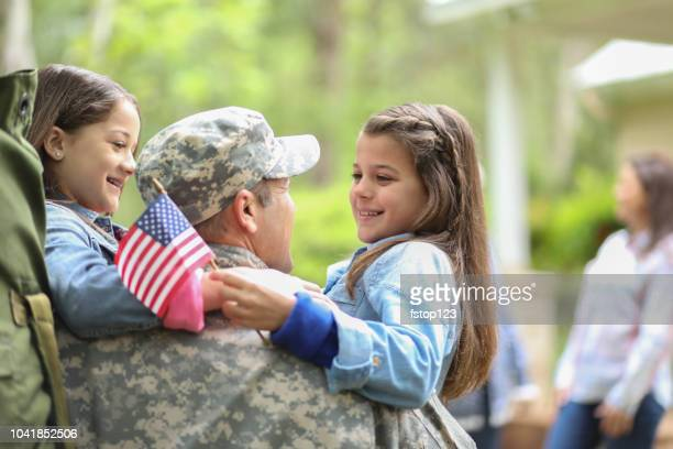 family welcomes home usa army soldier. - veterans day stock photos and pictures