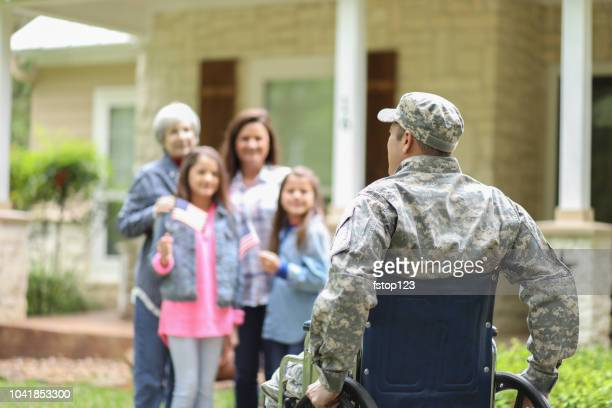 family welcomes home usa army soldier. - injured soldier stock photos and pictures