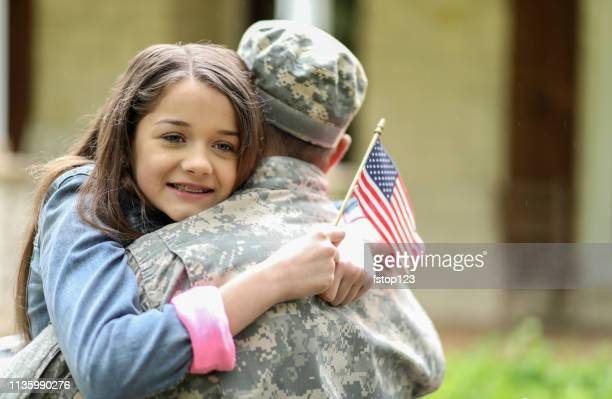 family welcomes home usa army soldier. - war memorial holiday stock pictures, royalty-free photos & images