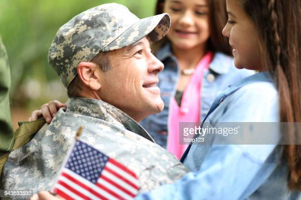 family welcomes home usa army soldier. - military flags stock photos and pictures