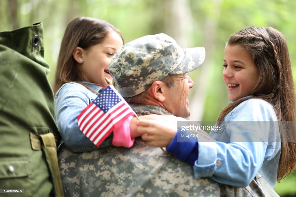 Family welcomes home USA army soldier. : Stock Photo