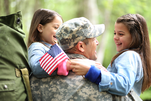 Family welcomes home USA army soldier. 943535576