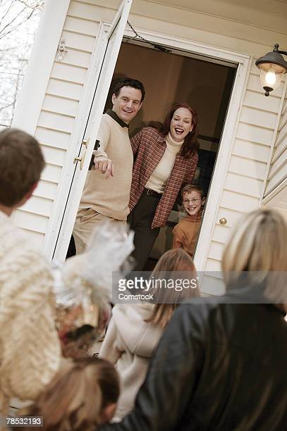 Family welcoming guests