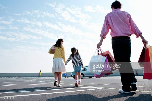 Family who finishes shopping and steps into a car