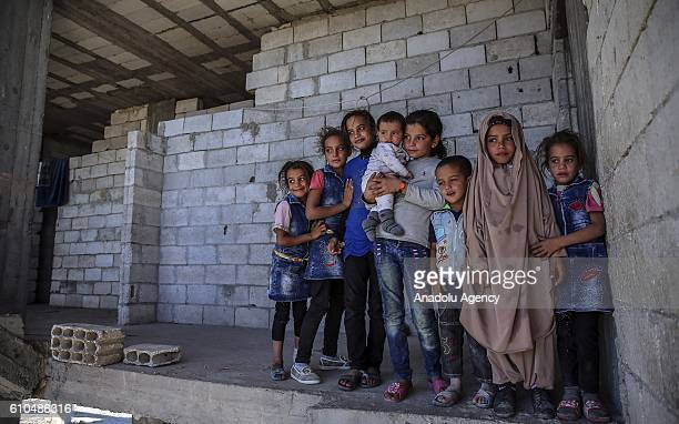 A family who lived wealthily before the war in Syria's Kobani take shelter at a construction in Jarabulus after the cleansing of Daesh in Jarabulus...