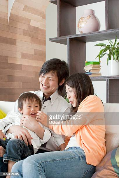 Family who spends happy time in living
