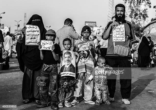 Family who support Egypt's ousted president Mohamed Morsi pose for a picture at Rabia Al-Adawiya Mosque in Cairo, Egypt, July 9, 2013.