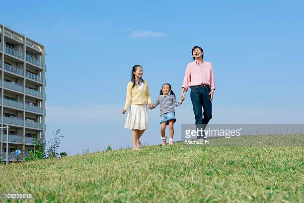 Family who walks happily in meadow