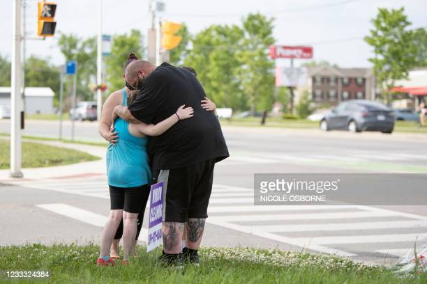 Family whose children went to school with a young victim, came to pay their respects and teach their kids about racism at the scene where a man...