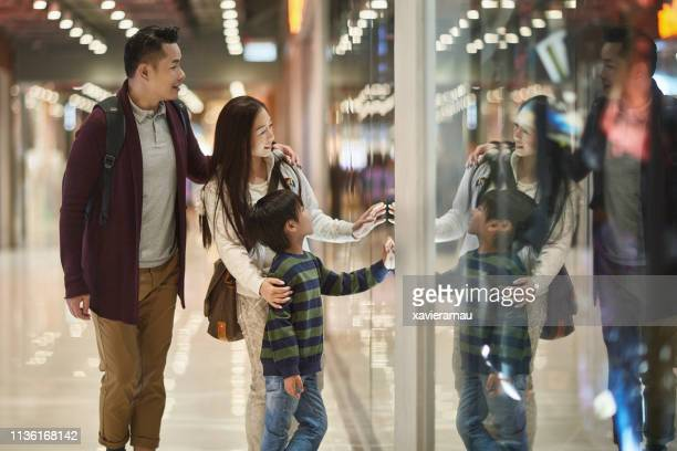 family window shopping in mall - fashion hong kong stock photos and pictures