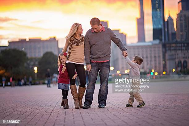 Family with 2 children dancing in Chicago