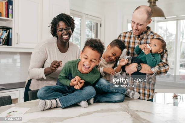 family with 3 little kids - mixed race person stock pictures, royalty-free photos & images