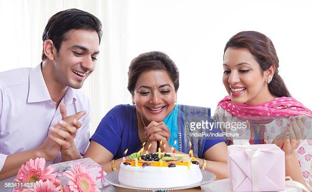 Family with a birthday cake