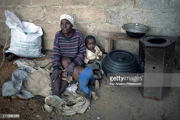 A family with a cook stove supplied by Clean Development Mechanism on June 14 in Lusaka Zambia CDM is one of the mechanisms in article 12 in the...