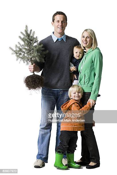 family with a pine tree