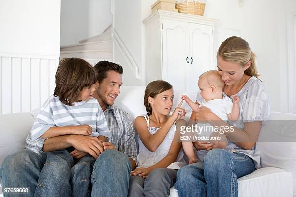 Family with baby on sofa