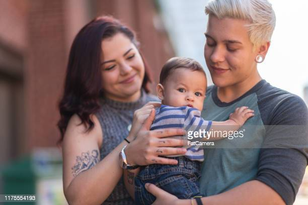 lgbt+ family with baby - non binary gender stock pictures, royalty-free photos & images