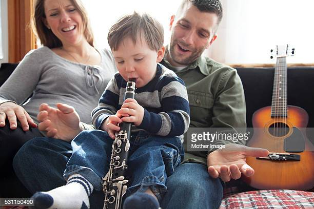 Family with child (2-3) playing together