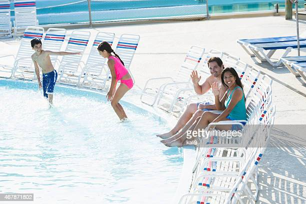 Family with children at a swimming pool