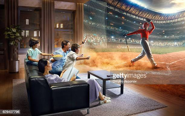 family with children cheering and watching baseball game on tv - baseball mom stock pictures, royalty-free photos & images