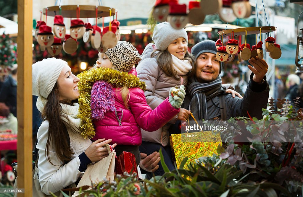 Family with children purchasing toys : Stock Photo