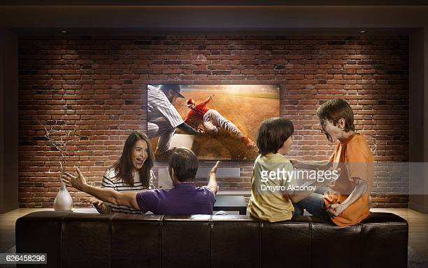 Family with children watching Baseball game on TV