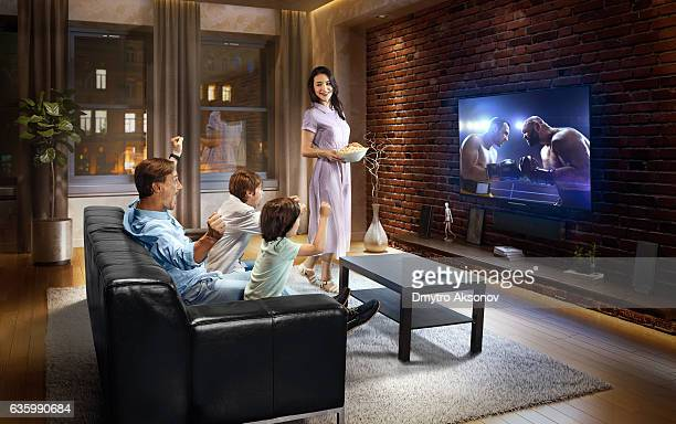 Family with children watching Boxing on TV