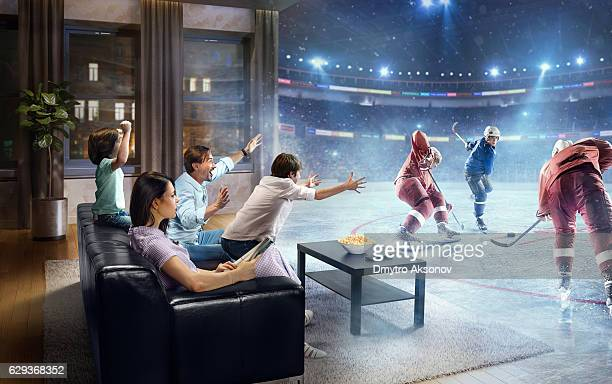 family with children watching ice hockey game on tv - taking a shot sport stock pictures, royalty-free photos & images