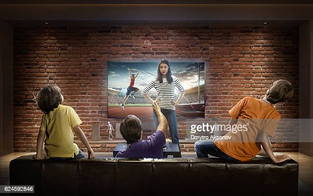 family with children watching pole vaulting competition on tv - sports event stock pictures, royalty-free photos & images
