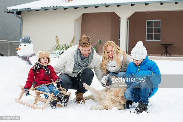 Family with dog and snowman