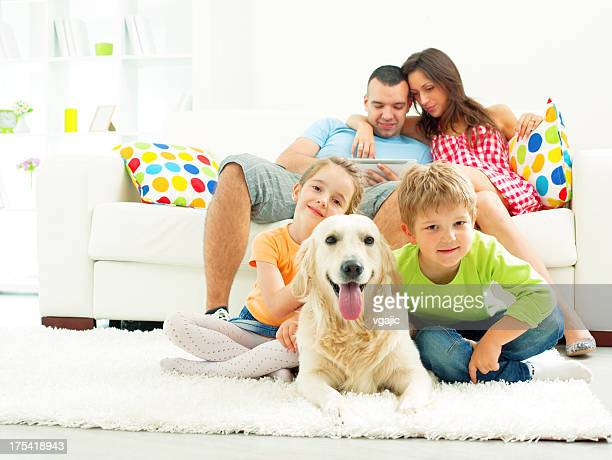 Family with dog enjoy at home.
