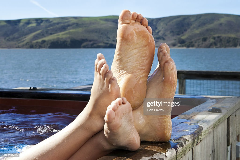Family With Feet Up Relaxing In A Jacuzzi Stock Photo | Getty Images