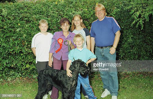 family with 'first prize' winning dog in garden, portrait - dog show stock pictures, royalty-free photos & images