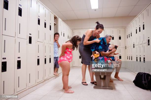family with four childs whom two are down's syndrome and autism - dressing room stock pictures, royalty-free photos & images