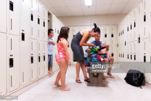 family with four childs whom two are down's syndrome and autism - locker room stock pictures, royalty-free photos & images