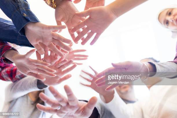 family with hands together - medium group of people stock pictures, royalty-free photos & images