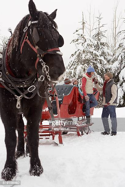 Family with horse drawn sleigh