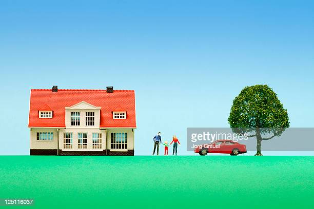 Family with house and car (scale models)