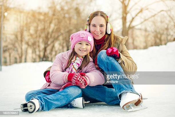 Family with ice-skates in winter outdoors