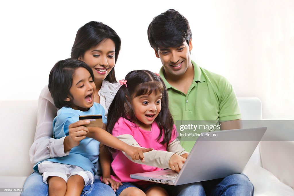 Family with laptop and credit card : Stock Photo