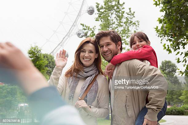 Family with London Eye in background, London, England, UK