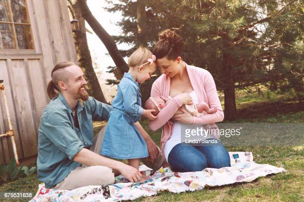 Family With Newborn Baby Outside