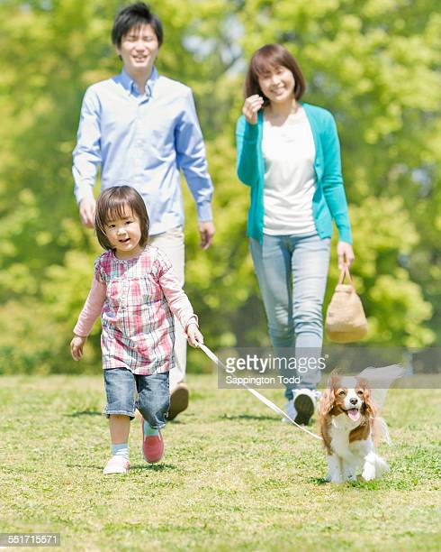 Family With One Child And Pet Dog