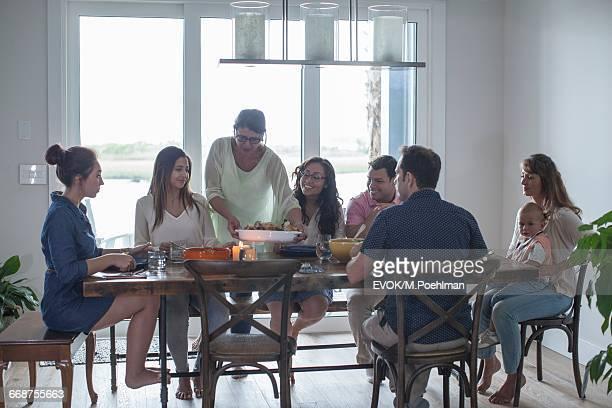 family with one child (18-23 months) at dinner table - aunt bildbanksfoton och bilder