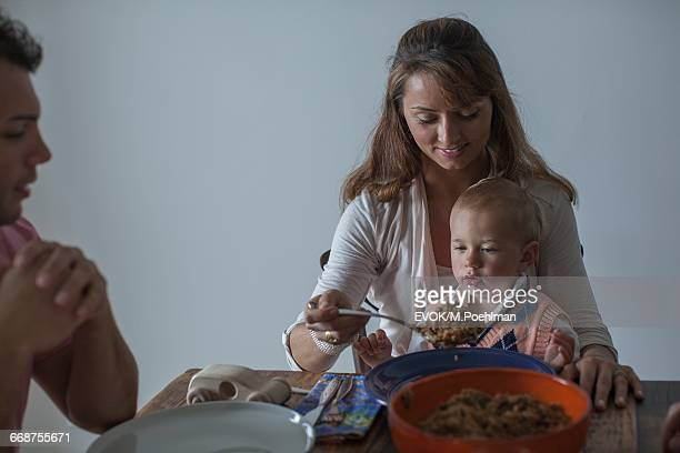 Family with one child (18-23 months) at dinner table